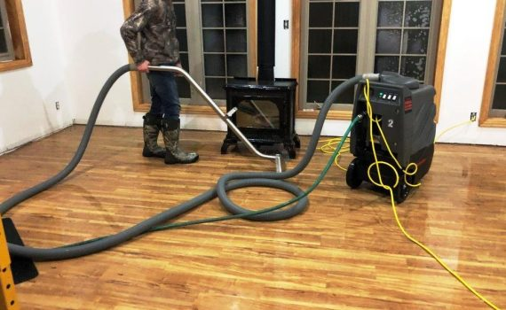 Extracting-Water-for-water-removal-wisconsin-ccs-property-services