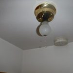 dripping water from a light fixture in a flooded apartment in green bay wisconsin