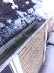 ice dams cleaned from roof and gutter in wisconsin